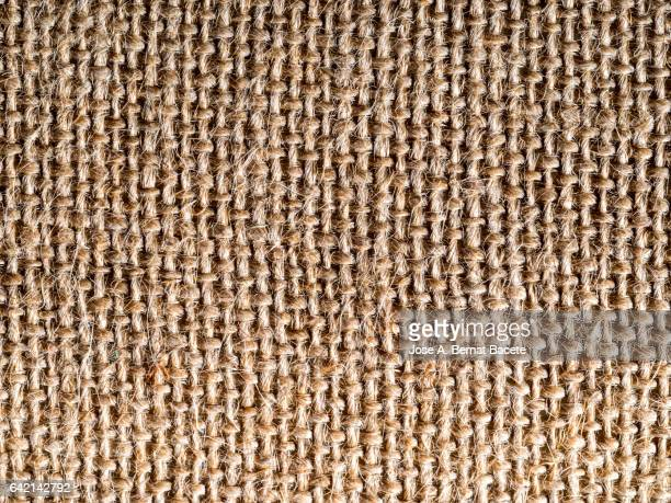 Full frame of the textures and colors of a fabric of burlap of brown color