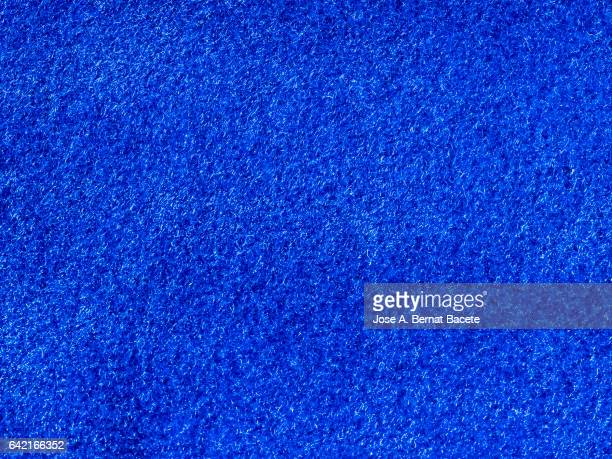 Full frame of the textures and colors of a fabric of textile of blue color