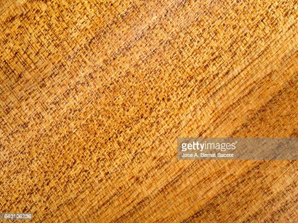 Full frame of the textures and colors of a table of noble wood