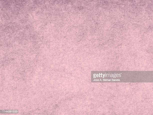 full frame of the textures formed by cardboard or paper ancient of pale pink color. - 薄ピンク ストックフォトと画像
