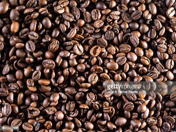 Full frame of the textures formed by roasted coffee beans.