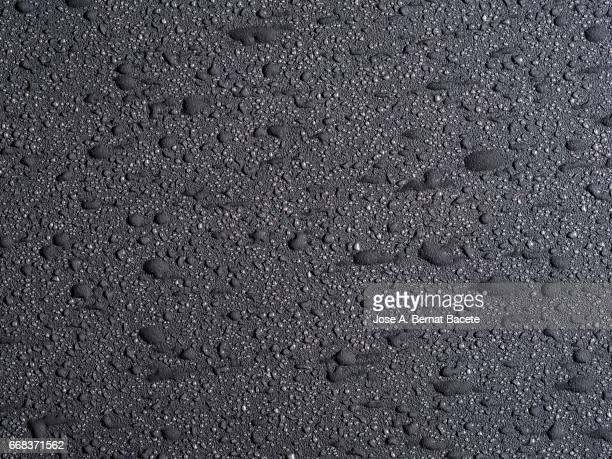 full frame of the textures formed by the bubbles and drops, on a smooth gray background - mojado stock pictures, royalty-free photos & images