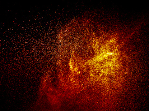 Full frame of the textures formed  by the water jets to pressure with drops floating in the air of color red and orange on a black background - gettyimageskorea