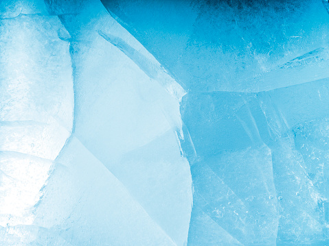 Full frame of the textures formed of a block of cracked ice, on a light blue background. - gettyimageskorea