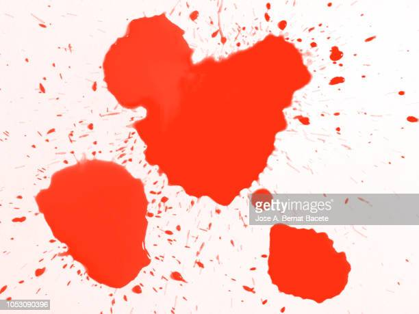 full frame of the textures formed of a drop of paint red color on a white background. - spotted stock-fotos und bilder