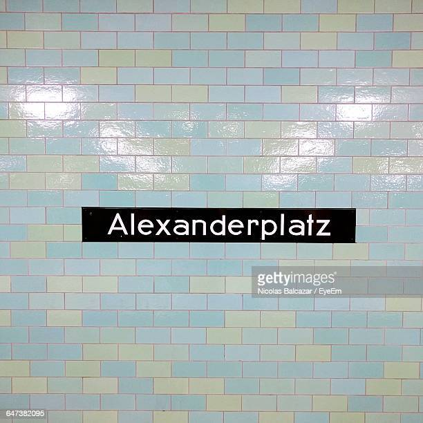 full frame of tile wall in subway station - underground sign stock pictures, royalty-free photos & images