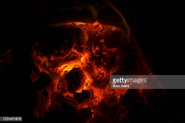 full frame of wood embers - ember stock pictures, royalty-free photos & images