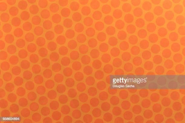 Full frame orange polka dot pattern