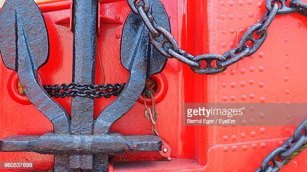 Full Frame Shot Anchor And Red Steel Background
