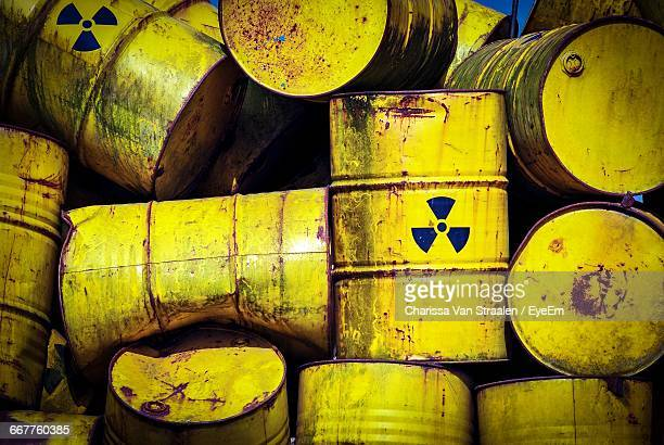 Full Frame Shot Of Abandoned Drums With Radioactive Warning Symbol