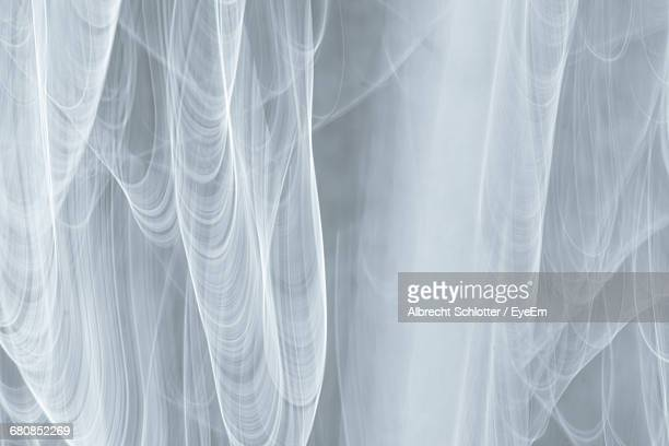 full frame shot of abstract patterned fabric against gray background - albrecht schlotter fotografías e imágenes de stock