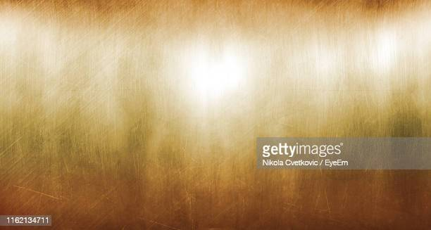 full frame shot of abstract patterned metal - gold metal stock pictures, royalty-free photos & images