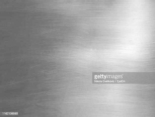 full frame shot of abstract patterned metal - stahl stock-fotos und bilder