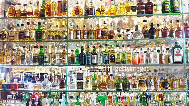 Full Frame Shot Of Alcohol Bottles In Shelf