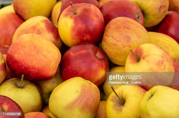 full frame shot of apples for sale at market stall - apple event stock photos and pictures