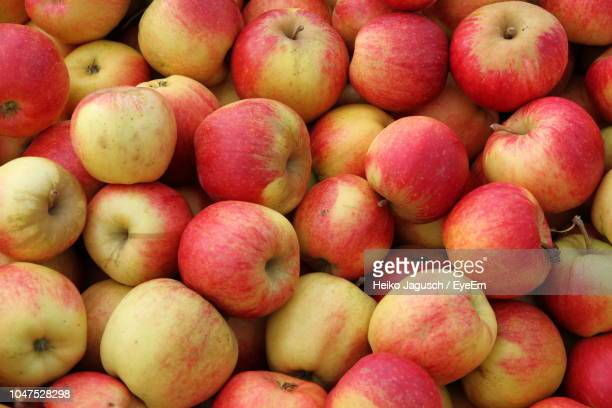 full frame shot of apples - apple event stock photos and pictures