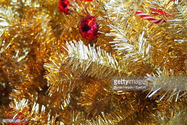full frame shot of artificial christmas tree - tinsel stock pictures, royalty-free photos & images