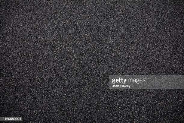 full frame shot of asphalt road - pavement stock pictures, royalty-free photos & images