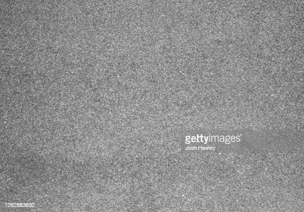 full frame shot of asphalt road - stoep stockfoto's en -beelden