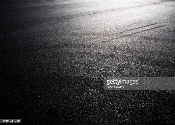 full frame shot of asphalt road - sports track stock pictures, royalty-free photos & images