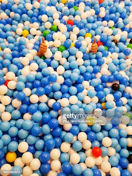 Full Frame Shot Of Ball Pool With Hands Showing Thumbs Up Sign