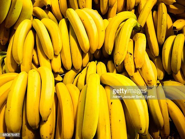full frame shot of bananas for sale at market stall - banana stock pictures, royalty-free photos & images