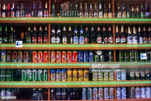 Full Frame Shot Of Beer Bottles In Shelves