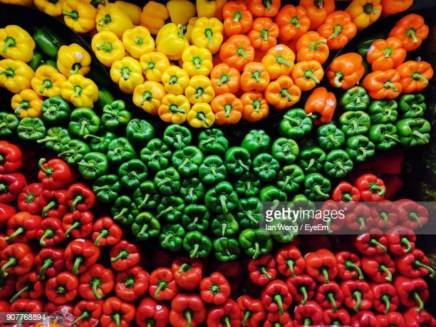 full frame shot of bell peppers for sale at market stall - green bell pepper stock pictures, royalty-free photos & images