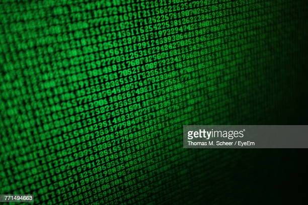 full frame shot of binary codes on device screen - binary code stock pictures, royalty-free photos & images