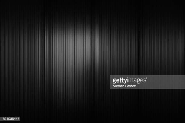 full frame shot of black corrugated wall - metallic stock photos and pictures