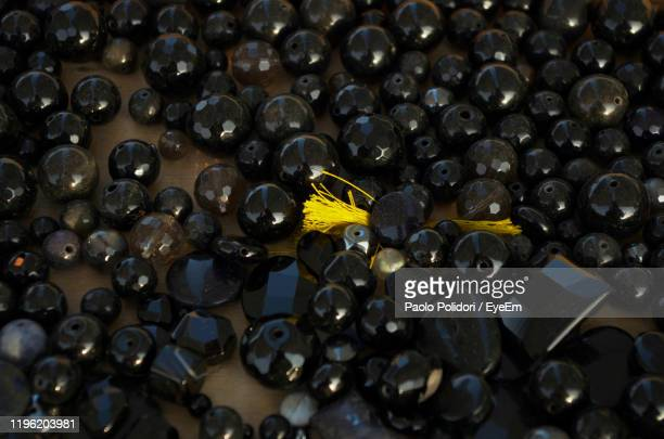 full frame shot of black decorations on table - onyx stock pictures, royalty-free photos & images