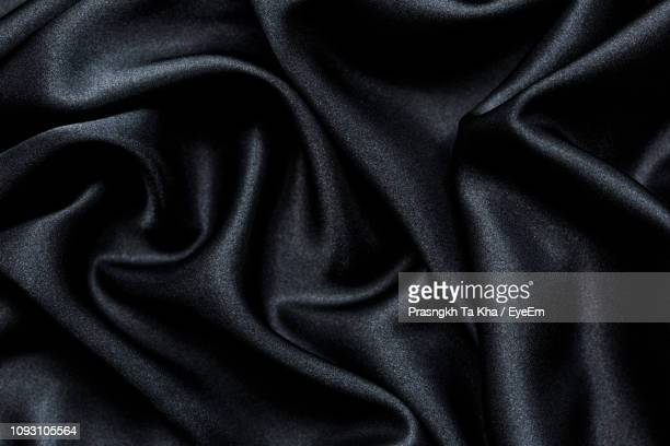 full frame shot of black fabric - satin stock pictures, royalty-free photos & images
