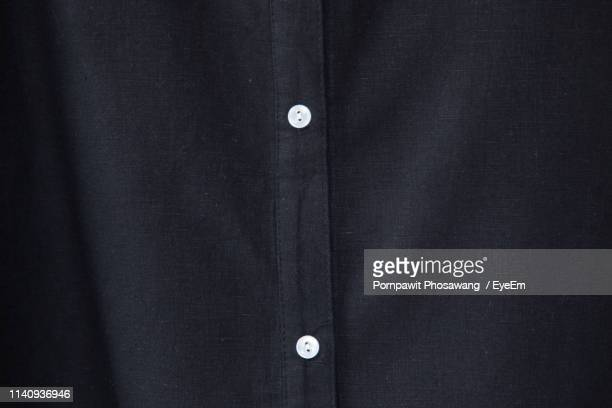 full frame shot of black shirt - zwart shirt stockfoto's en -beelden