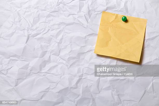 Full Frame Shot Of Blank Crumpled Paper With Yellow Note