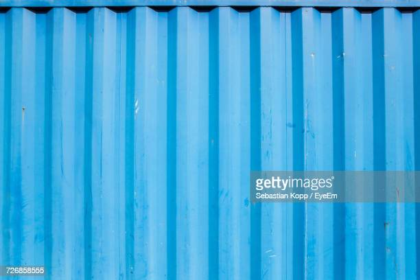 full frame shot of blue cargo container - container stock pictures, royalty-free photos & images