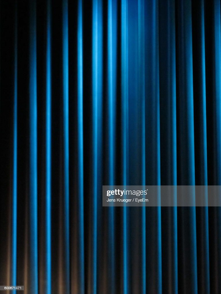 Full Frame Shot Of Blue Curtain In Theater : Stock Photo
