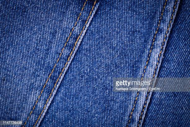 full frame shot of blue denim - denim stock pictures, royalty-free photos & images