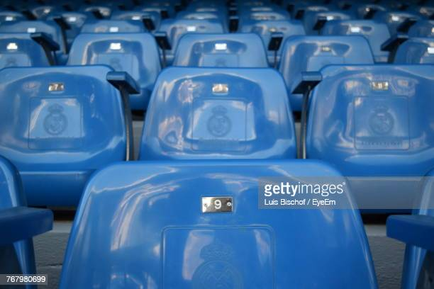 full frame shot of blue empty bleachers in stadium - empty bleachers stockfoto's en -beelden