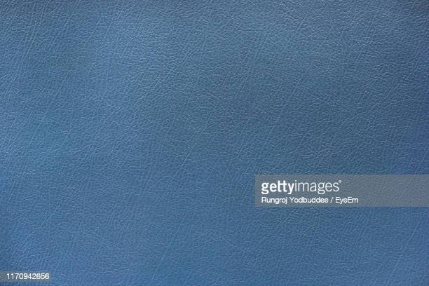 full frame shot of blue leather - leather stock pictures, royalty-free photos & images