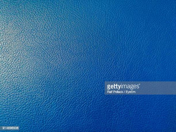 full frame shot of blue leather - leather stock photos and pictures