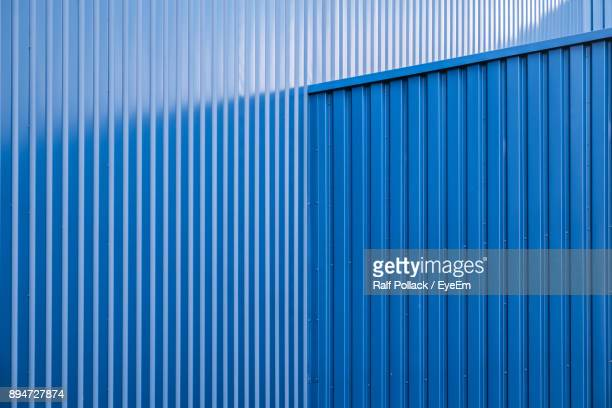 full frame shot of blue metal - corrugated iron stock photos and pictures