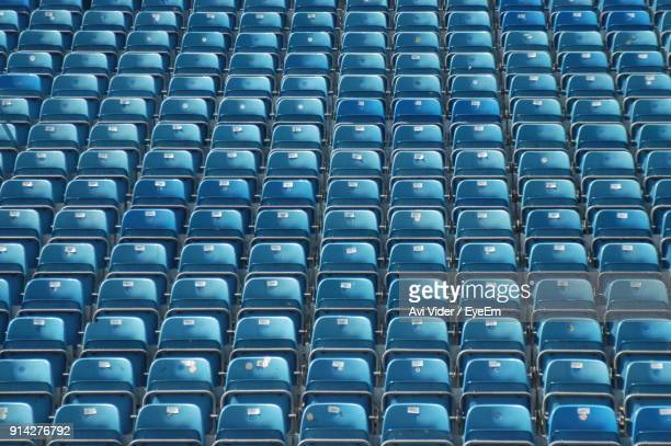 full frame shot of blue seats at stadium - repetition stock pictures, royalty-free photos & images