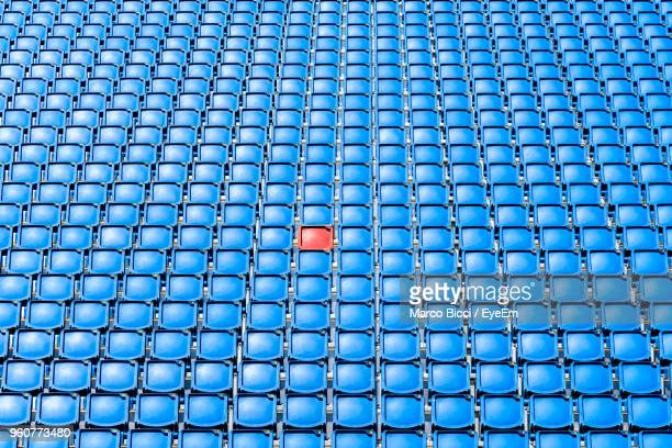 full frame shot of blue seats - standing out from the crowd stock pictures, royalty-free photos & images