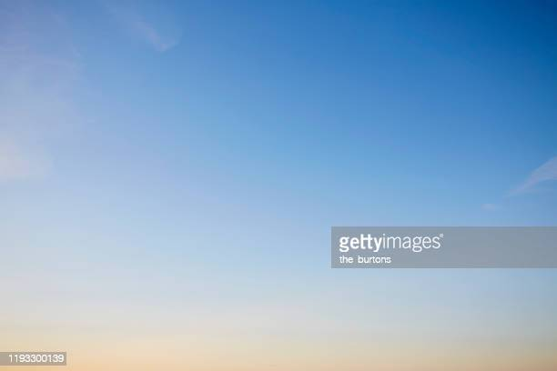 full frame shot of blue sky during sunset, color gradient and abstract background - himmel stock-fotos und bilder