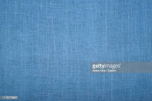 full frame shot of blue textile - textile stock pictures, royalty-free photos & images