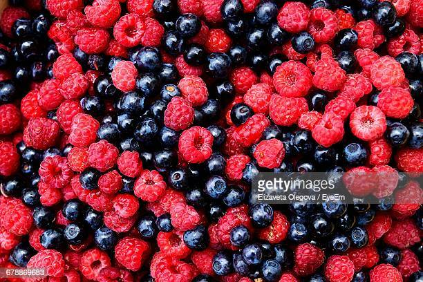 full frame shot of blueberries and raspberries - berry fruit stock pictures, royalty-free photos & images