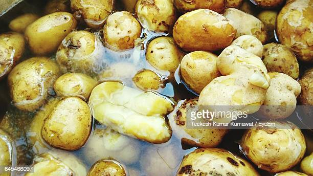 Full Frame Shot Of Boiled Potatoes In Water At Kitchen