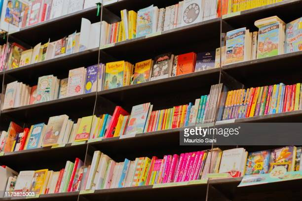 full frame shot of books for sale at store - picture book stock pictures, royalty-free photos & images