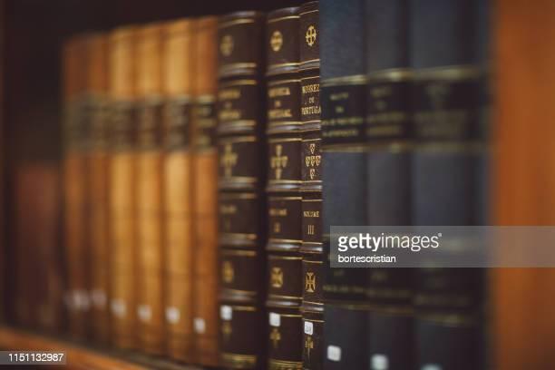 full frame shot of books in shelf - bortes imagens e fotografias de stock