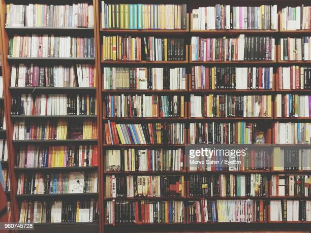 full frame shot of bookshelf - book shelf stock photos and pictures